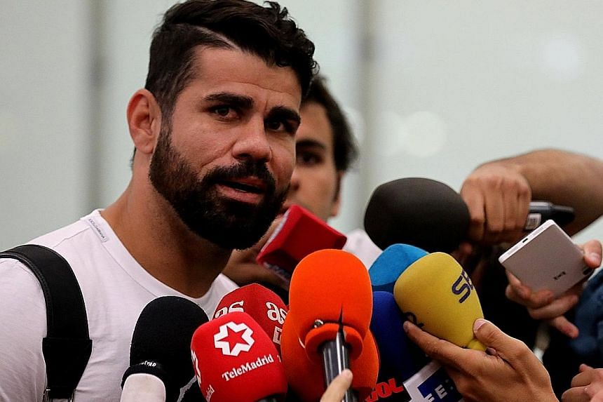 Chelsea's Diego Costa speaking to the media at Adolfo Suarez Madrid Barajas airport after arriving in the Spanish capital to finalise his transfer to Atletico Madrid. The Brazilian-born Spanish striker scored 20 goals to help Chelsea become English c