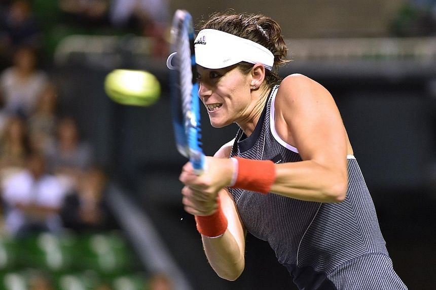 Garbine Muguruza on her way to beating France's Caroline Garcia 6-2, 6-4 in the quarter-finals of the Pan Pacific Open yesterday.