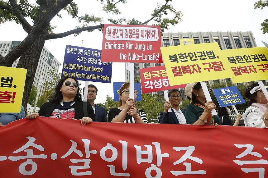 North Korean defectors protesting in Seoul yesterday against the South Korean government policy. The South had earlier approved US$8 million (S$10.8 million) worth of aid to the North.