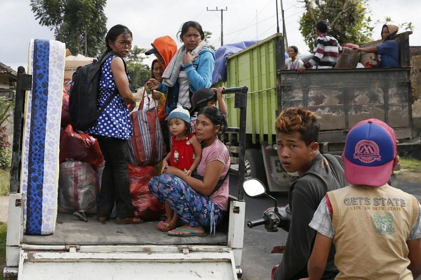 Residents evacuate following increasing seismic activity of Mount Agung in Karangasem, Bali, Indonesia, on Sept 22, 2017.