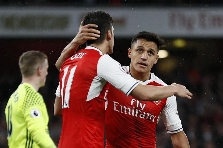Alexis Sanchez celebrating scoring Arsenal's first goal against Sunderland in the Premier League game on May 16, 2017 with Mesut Ozil. Both are in the final year of their contracts.