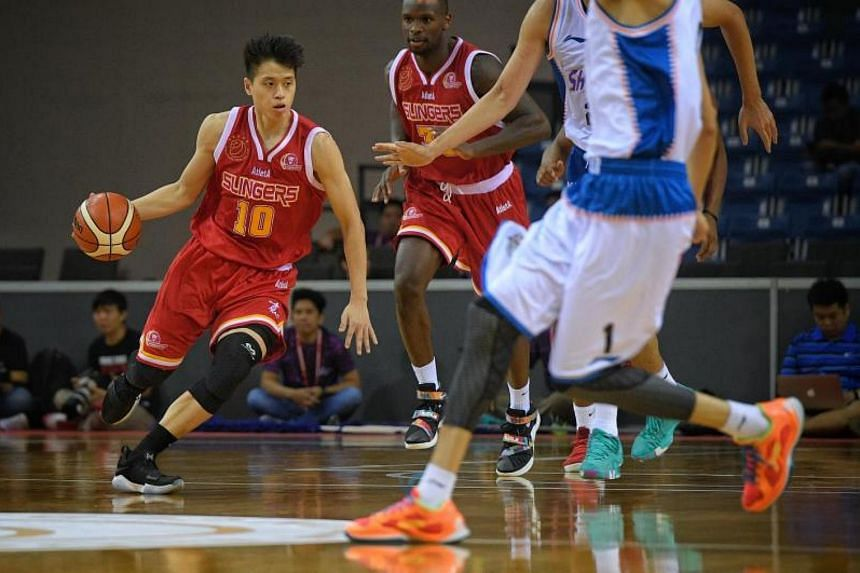 Leon Kwek (left) of the Singapore Slingers in action against the Shanghai Sharks during the Merlion Cup semi-final at the OCBC Arena on 23 September, 2017.