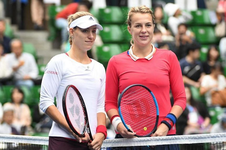 Anastasia Pavlyuchenkova of Russia (R) and Angelique Kerber of Germany pose for the media prior to their women's singles semi-final match at the Pan Pacific Open tennis tournament in Tokyo on Sept 23, 2017