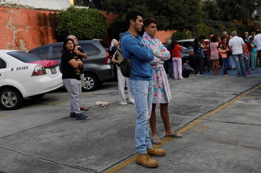 People gather inside a residential area after a tremor was felt in Mexico City, Mexico, on Sept 23, 2017.