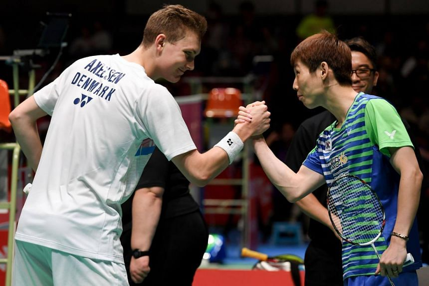 Viktor Axelsen of Denmark (left) shakes hands with Son Wan-Ho of South Korea before their men's singles semi-final match at the Japan Open Badminton Championships in Tokyo on Sept 23, 2017.