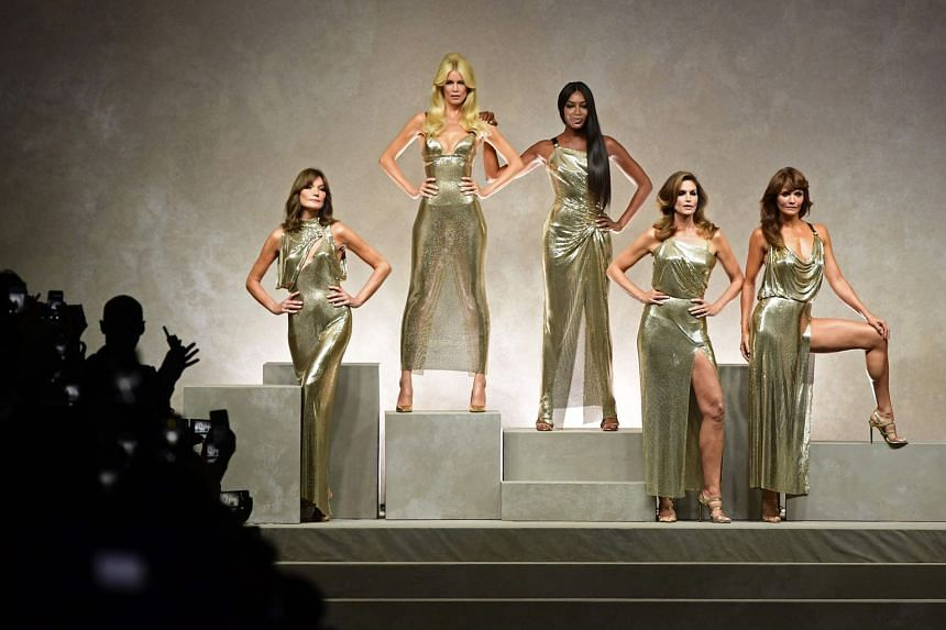 Top models (from left) Carla Bruni, Claudia Schiffer, Naomi Campbell, Cindy Crawford and Helena Christensen pose with Italian designer Donatella Versace (centre).