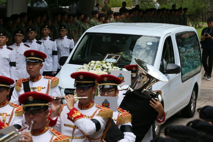 Servicemen of all ranks lined up on both sides of driveway of Mandai Crematorium, and the officers saluted the hearse as it arrived.