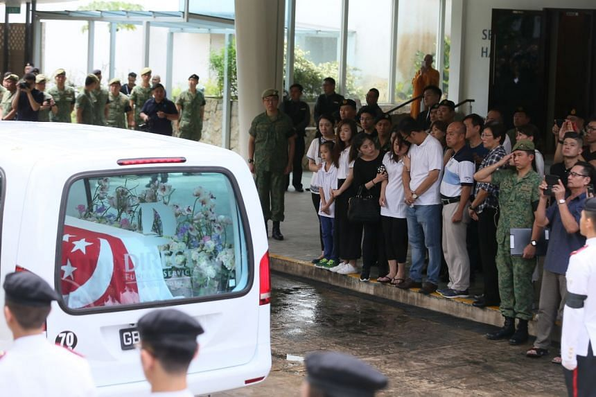 Family members and friends broke down when the hearse reached Mandai Crematorium.