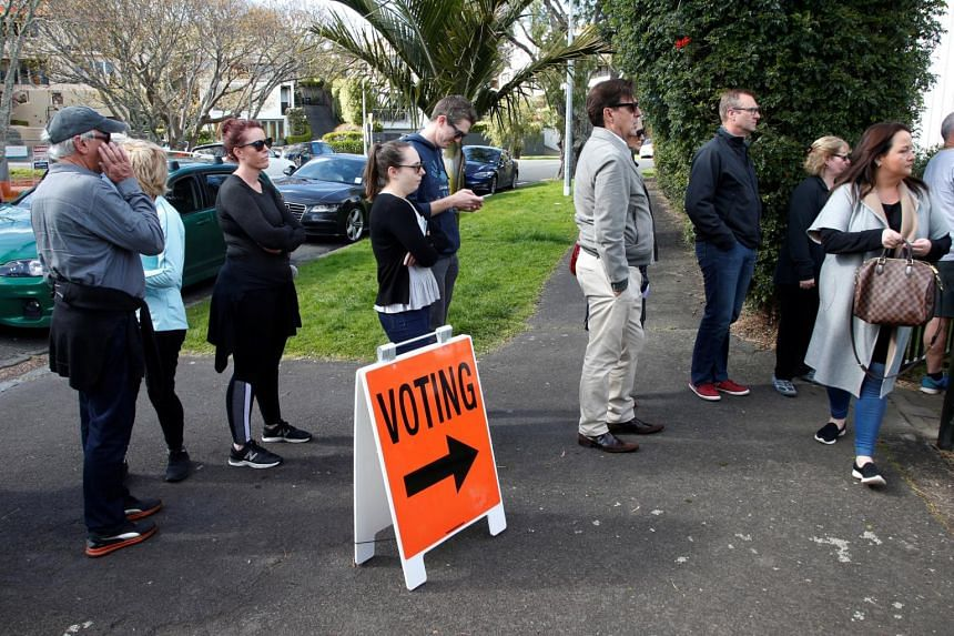 Voters wait outside a polling station at the St Heliers Tennis Club during the general election in Auckland, New Zealand, on Sept 23, 2017.
