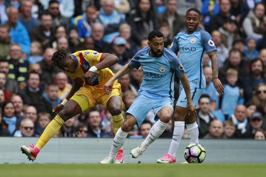 Crystal Palace's Wilfried Zaha in action with Manchester City's Gael Clichy and as Raheem Sterling looks on.