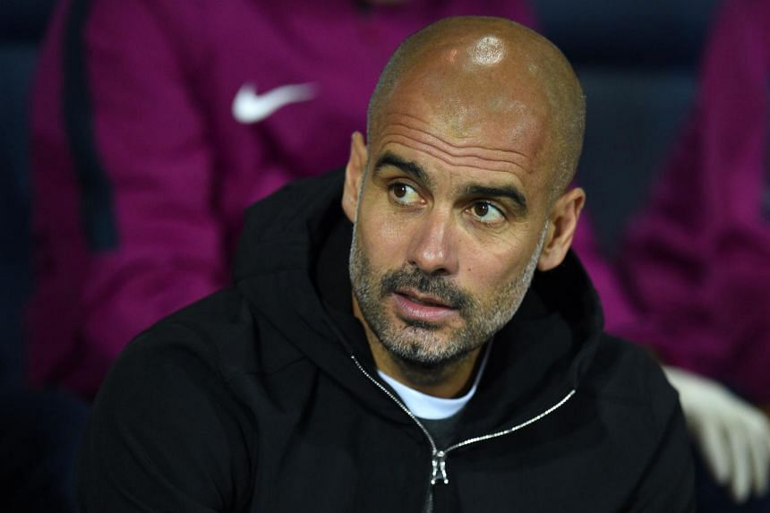 Manchester City's Spanish manager Pep Guardiola awaits kick off in the English League Cup third round football match between West Bromwich Albion and Manchester City, on Sept 20, 2017.