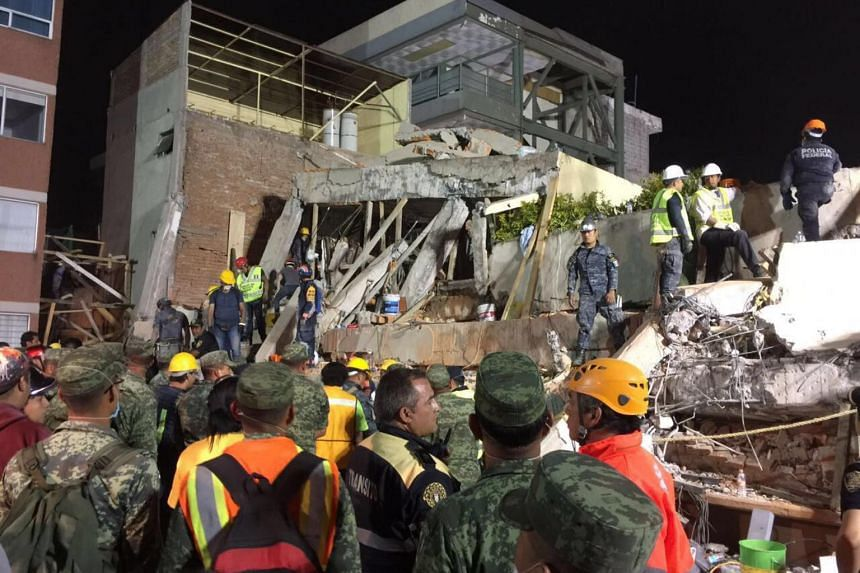 Rescue team work at the Rebsamen school in Mexico City early morning, on Sept 20, 2017.