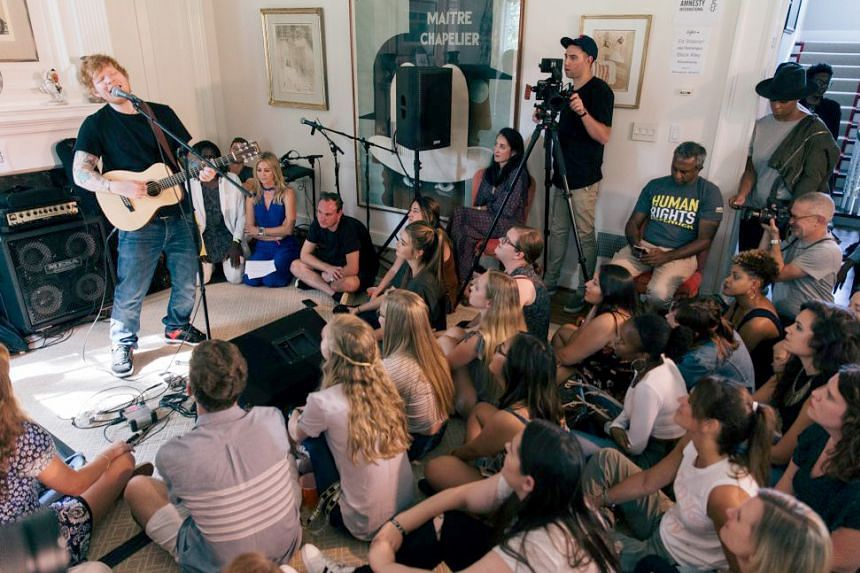 Singer Ed Sheeran performed a 20- minute set for about 70 people in a living room in Washington, DC, as part of the Give A Home concert series, where all proceeds go towards refugee support.