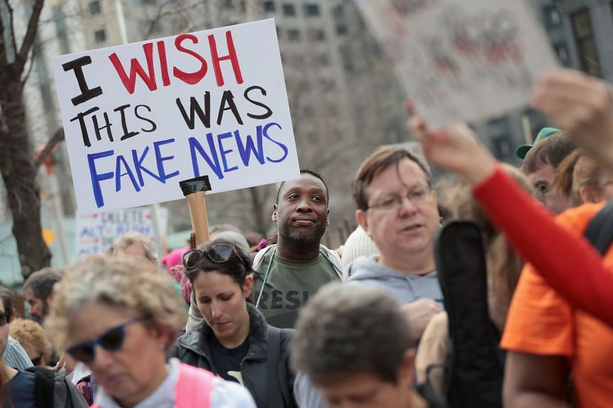 Protesters staging a demonstration near the Trump Tower in Chicago on Feb 20, during the country's annual Presidents' Day. What constitutes fake news can be hard to nail down, especially when the term is co-opted by leading figures to refer to an