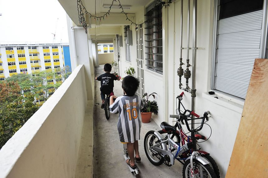 Children playing along the corridor of two-room HDB flats in Boon Lay Drive. One key change that unmarried parents are seeking is to allow them equal access to HDB flats as married couples, instead of making them wait till they are aged 35 and limiti