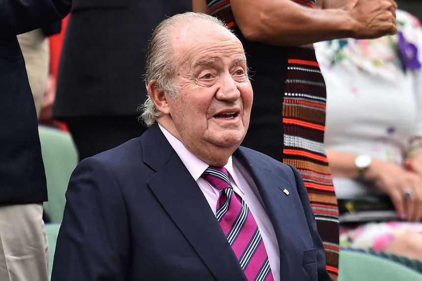 Juan Carlos, former king of Spain, takes his seat in the royal box at Wimbledon in July 2017.