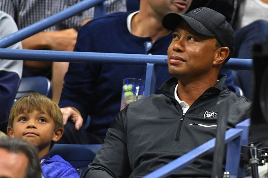 Tiger Woods and his son Charlie watch Rafael Nadal at the US Open 2017.