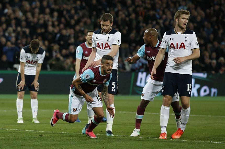 West Ham United's Manuel Lanzini celebrates scoring their first goal.