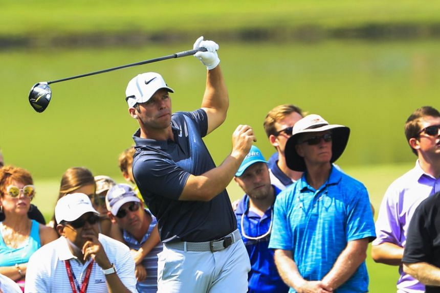 Paul Casey of England hits his tee shot on the fourth hole during the third round.