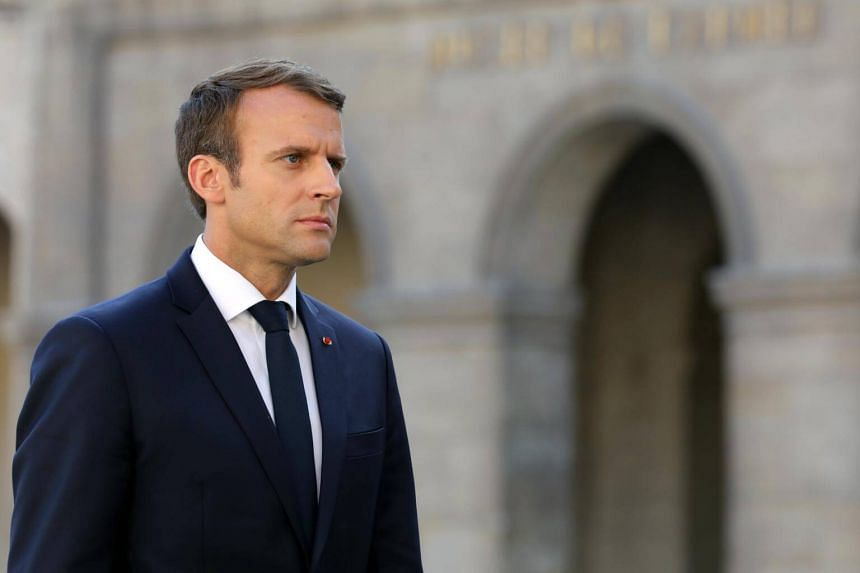 French President Emmanuel Macron looks on during a ceremony in tribute to late French WWII colonel Fred Moore at the Hotel des Invalides in Paris, France,  on Sept 22, 2017.