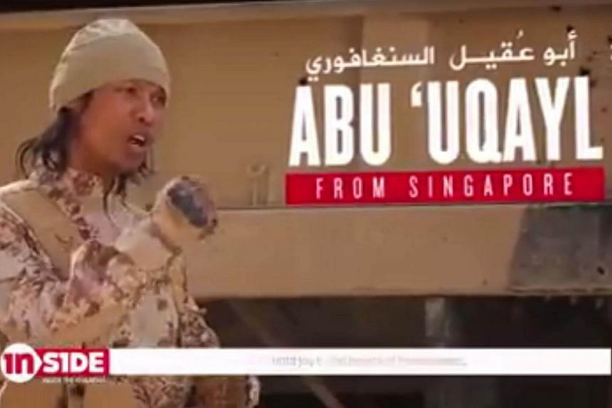 """In the video, Abu 'Uqayl is seen firing off a round on a truck-mounted artillery gun, with the caption reading """"power is shooting""""."""