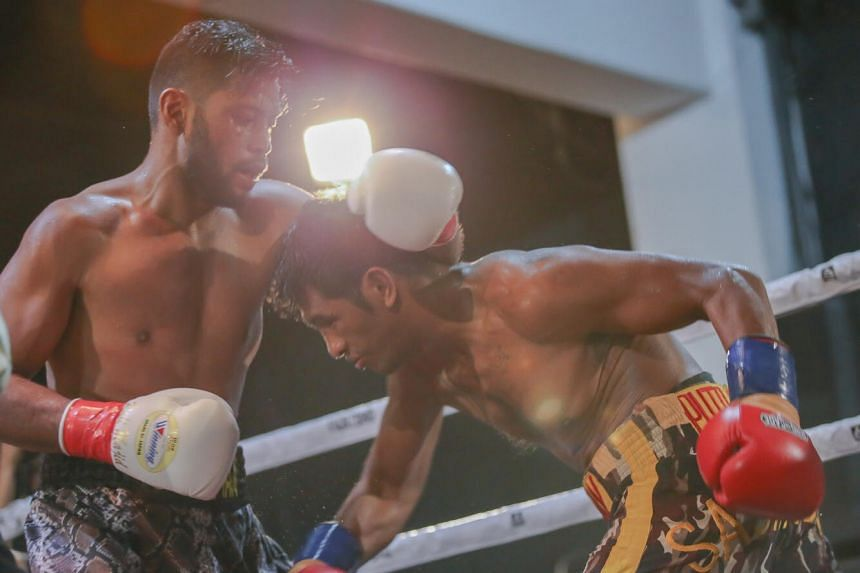 Singapore's Rafi Majid (left) clinched the vacant WBC Asia silver super middleweight championship belt after scoring a fourth-round technical knockout against Indonesia's veteran boxer Maxi Nahak.