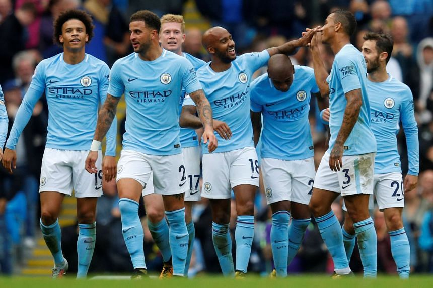 Manchester City's Fabian Delph celebrates scoring their fifth goal with team mates.
