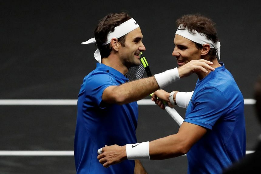 Rafael Nadal and Roger Federer of team Europe celebrate after winning the match.