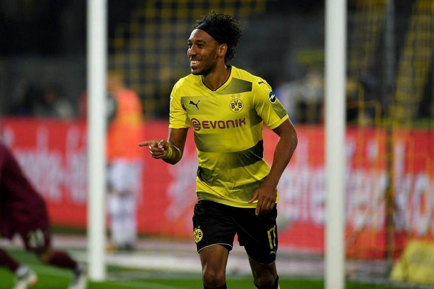 Dortmund's Gabonese striker Pierre-Emerick Aubameyang celebrates scoring during the German First division Bundesliga football match between Borussia Dortmund  and Borussia Moenchengladbach in Dortmund, western Germany, on Sept 23, 2017.