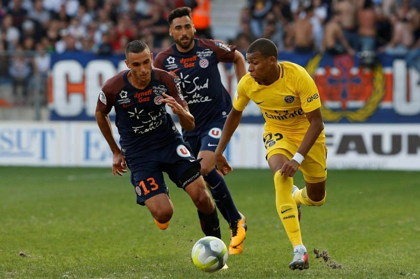 Paris Saint-Germain's Kylian Mbappe in action with Montpellier's Ellyes Skhir on Sept 23, 2017.