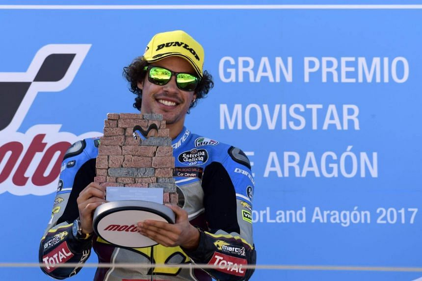 First placed EG 0,0 Marc VDS' Italian rider Franco Morbidelli celebrates on the podium after the Moto 2 race of the Moto Grand Prix of Aragon at the Motorland circuit in Alcaniz on Sept 24, 2017.
