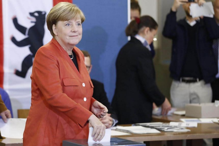 German Chancellor and CDU party leader Angela Merkel casts her vote at a polling station during general elections in Berlin, on Sept 24, 2017.