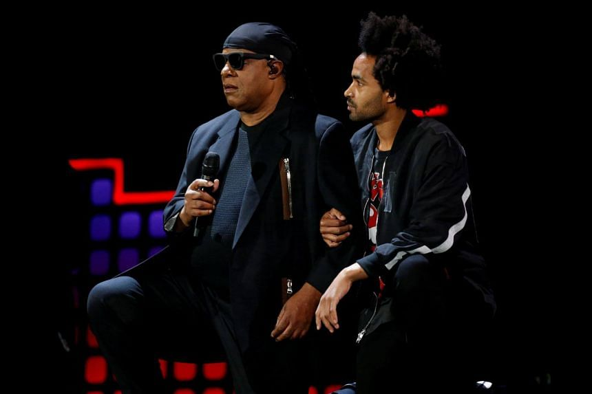 Singer Stevie Wonder takes a knee with the help of his son Kwame Wonder before performing at the 2017 Global Citizens Festival at Central Park in New York, on Sept 23, 2017.