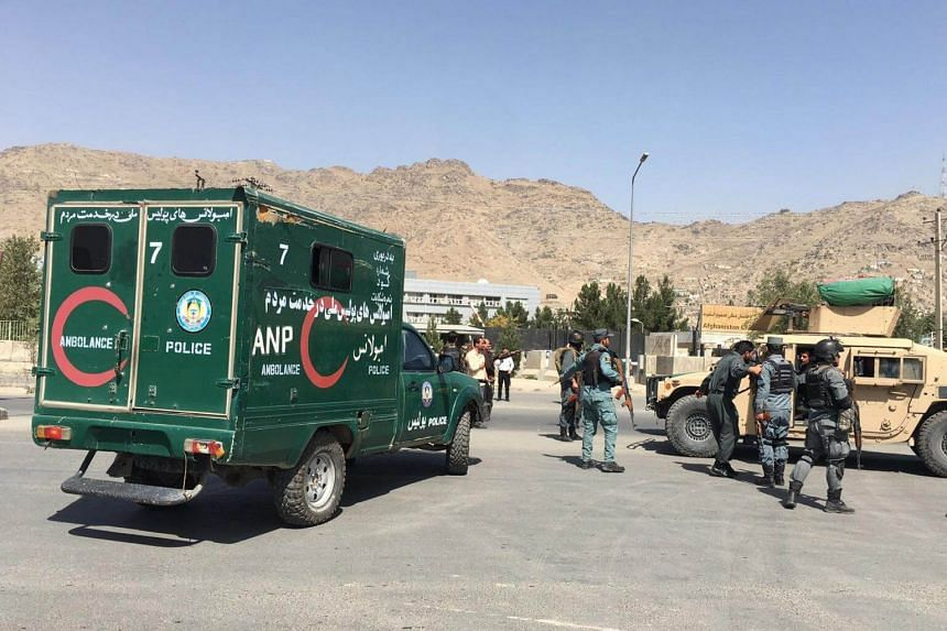 Afghan police secure the scene of a suicide bomb attack in Kabul, Afghanistan, on Sept 24, 2017.
