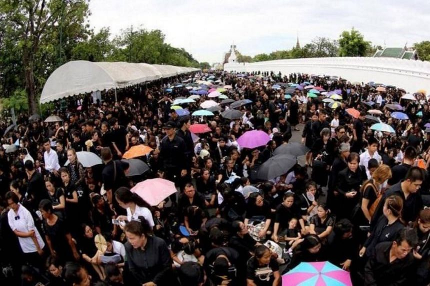 Thousands of people formed long lines outside Thailand's Grand Palace to lay prostrate before the Royal Urn and pay respects to the late King Bhumibol Adulyadej in Bangkok on Sept 24, 2017.