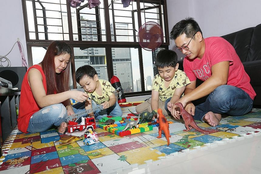 Mr Alan Woo and Ms Patricia Koh with their boys, Valerian, three, and Victor, seven, who have both been Mensa members since they were about two. Ms Koh said she enrolled her sons in the organisation as she wanted them to have an environment where the