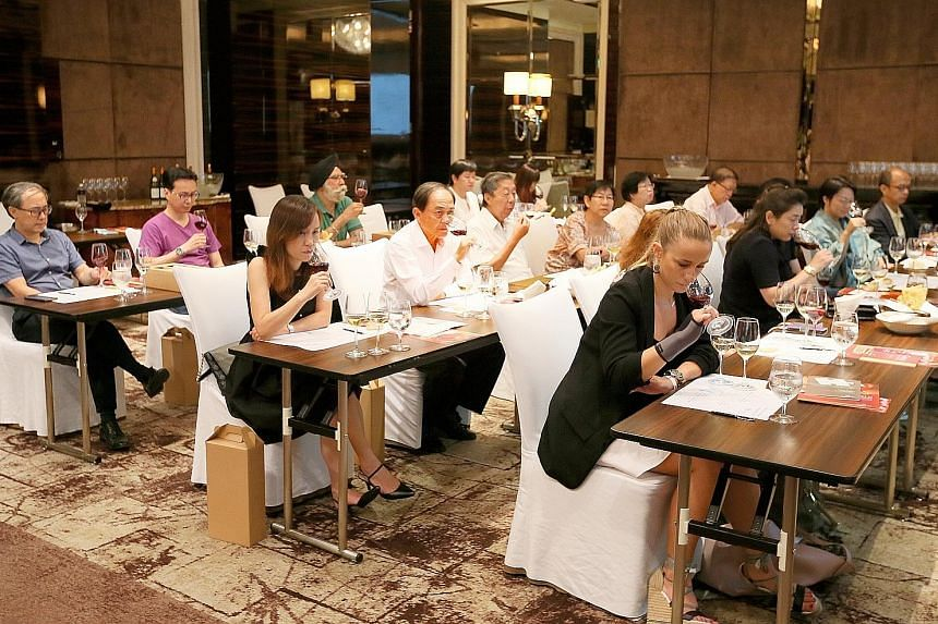 The masterclass held yesterday at the St Regis was attended by over 30 participants who each took home $135 worth of goodies. They got to taste six wines from Burgundy, including three not yet available on the market, and premium Pinot Noirs.
