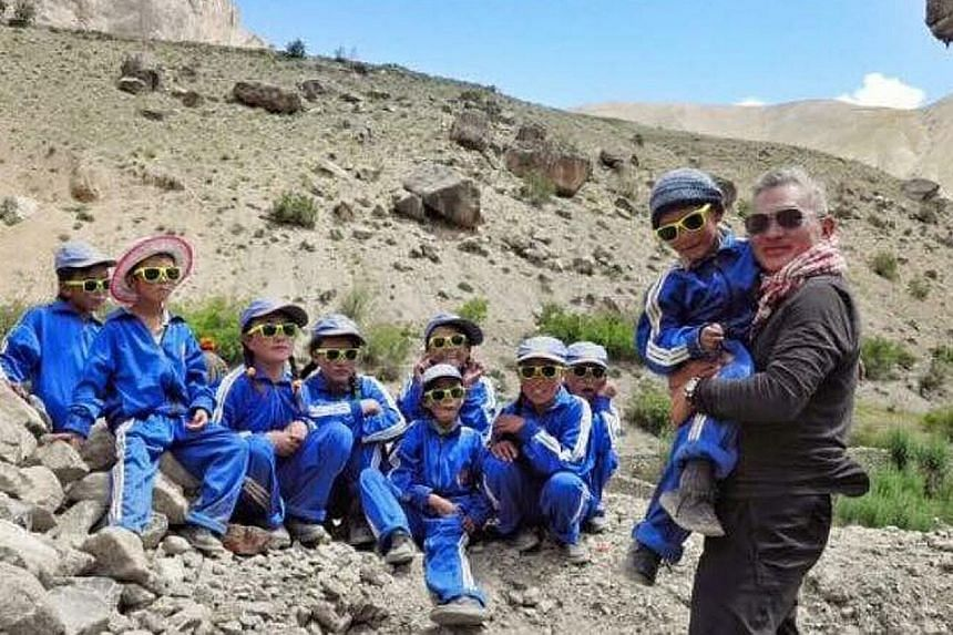 Mr Yip with children in Ladakh while on a trip organised by Singapore NGO Sight To Sky. Many people in the Indian region have vision problems because of exposure to the sun's ultraviolet rays. Mr Vince Yip, who brought award-winning Australian gelato