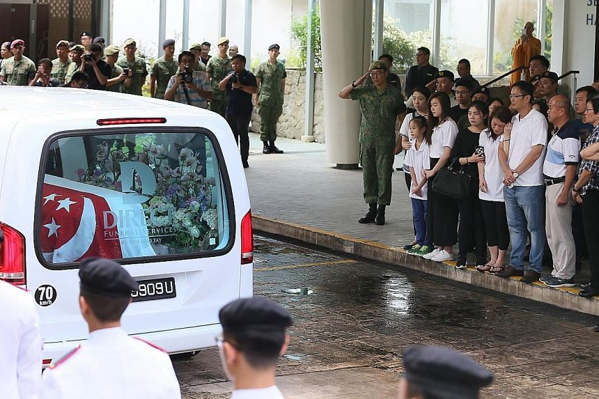 At the Mandai Crematorium yesterday, apart from family and friends, 300 servicemen lined the driveway to receive 3SG Gavin Chan's hearse. Later, six soldiers fired three volleys as a salute, and a minute of silence was observed as the bugler sounded
