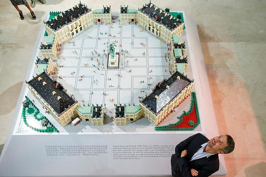 […]Danish Crown Prince Frederik standing next to a model of Amalienborg Palace - home of the Danish royal family - made of Lego bricks at the Danish Cultural Centre in Beijing yesterday.