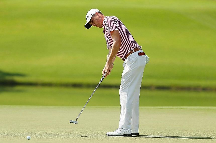 Justin Thomas putting on the eighth green in the second round of the Tour Championship. He eagled the final hole with a superb approach shot to share the halfway lead with Webb Simpson and Paul Casey.