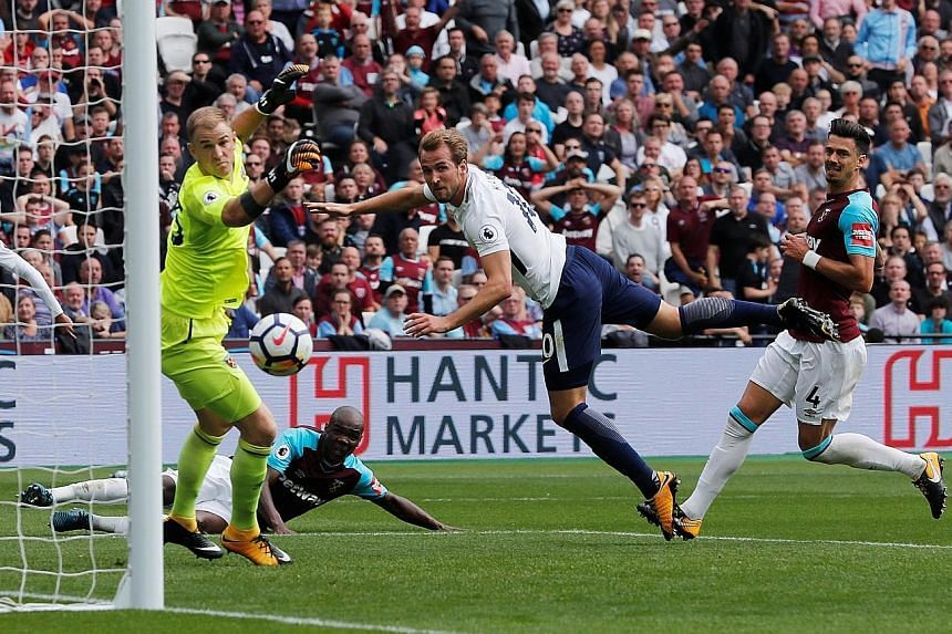 Spurs' Harry Kane opens the scoring with a fine header past West Ham's Joe Hart yesterday at the London Stadium.