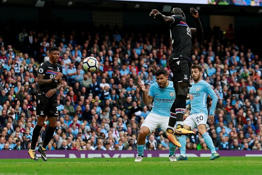 Sergio Aguero putting Manchester City four up, after Crystal Palace's goalkeeper Wayne Hennessey was unable to keep out the Argentinian's header. City's win compounded the misery on Roy Hodgson's side, while keeping them ahead of city rivals United a