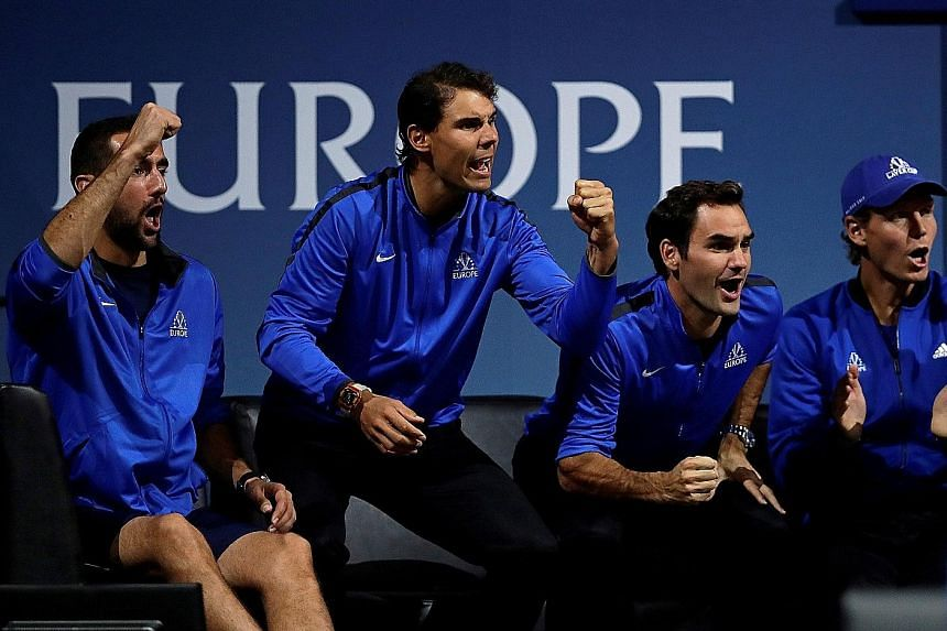 (From left) Marin Cilic, Rafa Nadal, Roger Federer and Tomas Berdych cheering on Team Europe against Team World in Prague. The Europeans swept the singles to lead 3-0 before Nadal and Berdych lost the doubles.