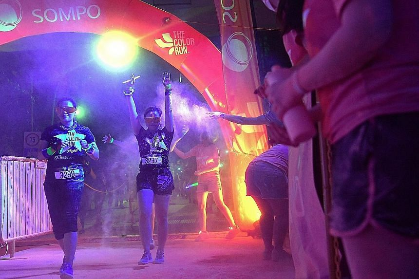 About 9,000 participants ran a 5km loop around Palawan Green in Sentosa as glow-in-the-dark powder bathed them in iridescent, neon particles. The Colour Run, in its fifth edition here, took on a different tinge this year by taking place at night - th