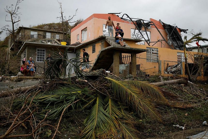 A damaged house in Yabucoa, Puerto Rico, in the aftermath of Hurricane Maria, which has killed at least 25 people across the Caribbean, according to officials and media reports.