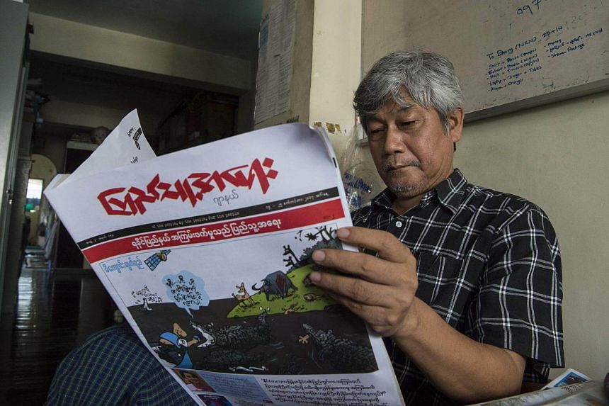 A newspaper's front page with a sketch called crocodile tears by one of Myanmar's most famous cartoonists Win Naing, whose pen name is Aw Pi Kyeh, in Yangon.
