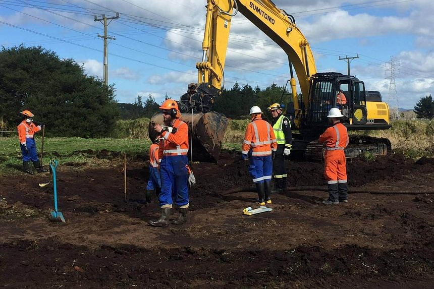 Workers repair part of a pipeline in Northland, New Zealand on Sept 20, 2017.