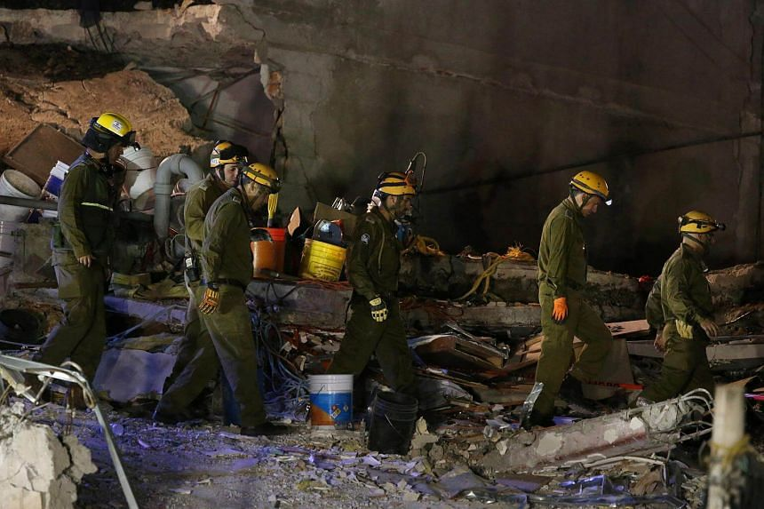 An Israeli rescue team searches for survivors in the rubble of a collapsed building after an earthquake in Mexico City on Sept 23, 2017.