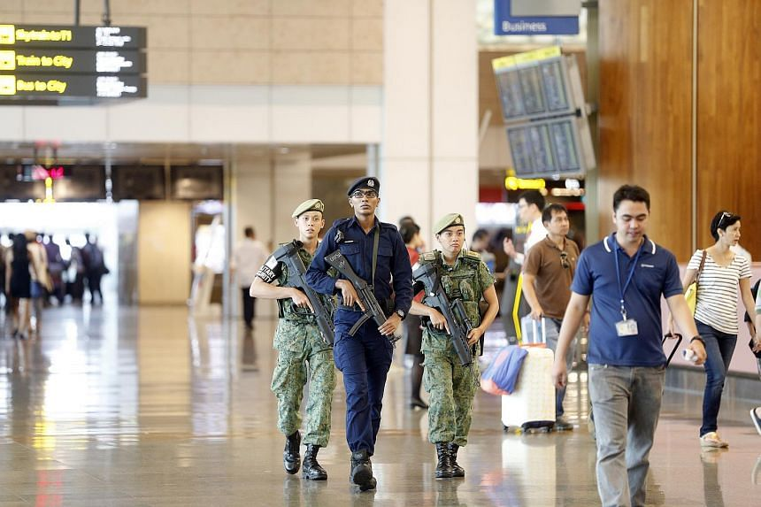 Security personnel on patrol at Changi Airport.